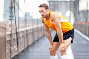 Running man resting after run in New York City